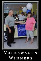 March of Dimes & Jim Ellis Volkswagen present a new Beetle to the winning family.  17 June 2006